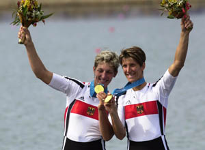 Germany's Jana Thieme, left, and Kathrin Boron celebrate with their gold medals for the double sculls Saturday, Sept. 23, 2000, at the Sydney International Regatta Center in Penrith, Australia. (AP Photo/Kathy Willens)