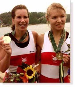 GAN16:SPORT-OLYMPICS:LAKE LANIER,GAINESVILLE,GEORGIA,27,JUL96 - Canada's Marnie McBean (L) and Kathleen Heddle (R) show off their Gold Medals they won in the Womens Double Skulls Final at Lake Lanier during the 1996 Olympics. nd/DIGITAL/Photo by Nick Didlick REUTERS