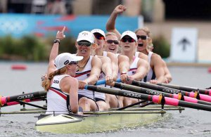 Cox Mary Whipple, Caryn Davies (s), Caroline Lind, Eleanor Logan, Meghan Musnicki, Taylor Ritzel, Esther Lofgren, Zsuzsanna Francia, and Erin Cafaro (b) of the United States of America celebrate after winning the gold medal in the women's eight Final A at the 2012 Olympic Rowing Regatta at Eton-Dorney near London, Great Britain.