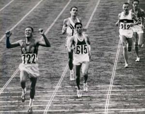 20-BillyMills_Crossing_Finish_Line_1964Olympics