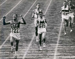 20-BillyMills_Crossing_Finish_Line_1964Olympics