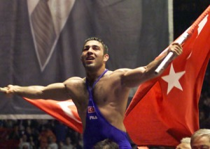 Turkey's Hamza Yerlikaya waves Turkish flags in front of a huge poster of Mustafa Kemal Ataturk in Istanbul on Sunday, May 13, 2001 after the European Greco-Roman Wrestling Championship 85 kg final. Hamza Yerlikaya of Turkey won the gold medal by defeating Marcin Letki of Poland. Mustafa Kemal Ataturk is the founder of the Turkish Republic. (AP Photo/Murad Sezer)
